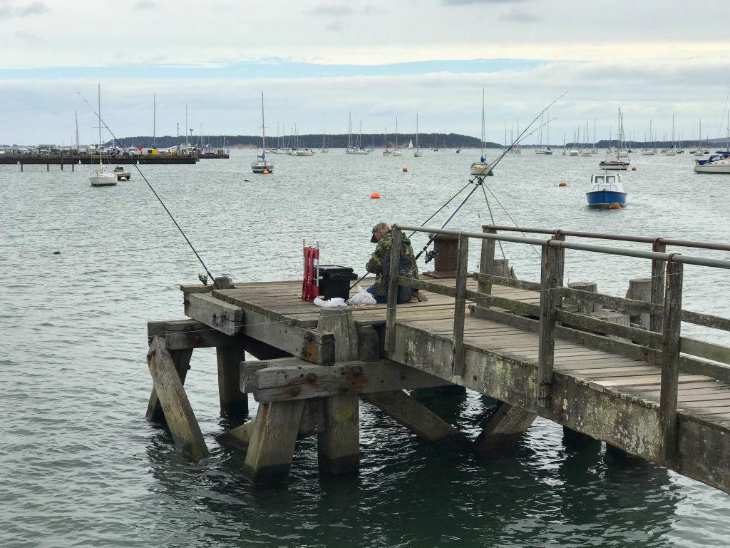 Fisherman on Lake Pier, Poole